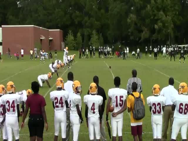 Chris Scott playing football against Beach High School - Boys ...
